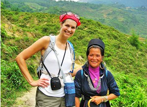 Lady traveller hiking through the hills of Sapa with a local Vietnamese lady