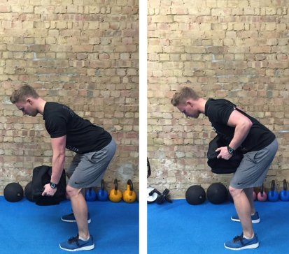 Fitness trainer doing a bent over row