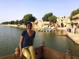 Customer sitting at a viewpoint overlooking Jaisalmer Lake
