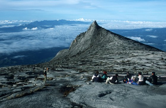 Looking from the summit trail on Mount Kinabalu (at 4101m, the highest peak in SE Asia) past 4032m Kinabalu South towards the Crocker Range, western Sabah, Malaysian Borneo.