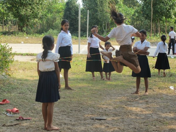 Cambodian school children skipping