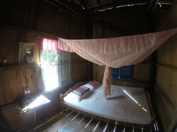 The bedroom of a Cambodian homestay with mosquito net