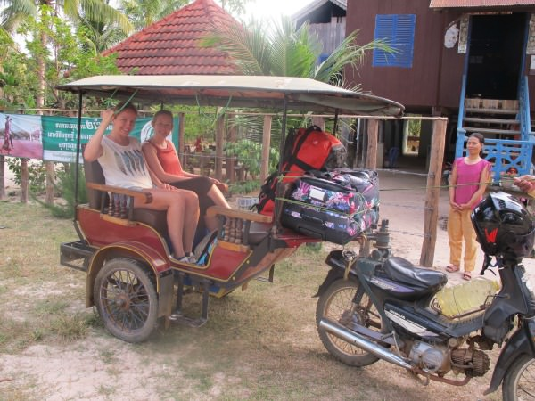 Two women arriving at their homestay in Cambodia