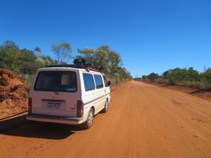 Camper van driving through desert in Australia