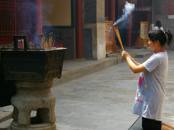 China-Beijing-Landmarks-Lama-Temple-local-woman-with-incense-by-Jennifer-Parker