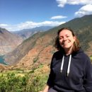 Japan travel specialist Fiona posing in front of rice terraces