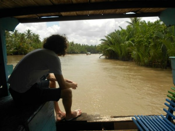 Vietnam travel specialist Paul on a boat trip looking out at the Mekong Delta in Vietnam