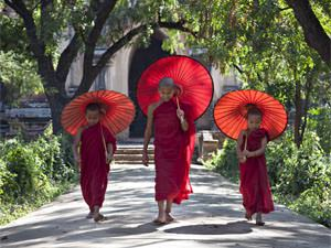 Local Burmese people dressed in red robes in Bagan, Myanmar