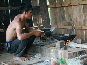 local man cooking in cambodia