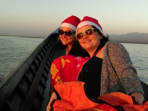 ceri and alanna on inle lake in christmas hats
