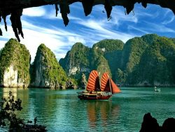 Chinese junk boat sailing across Bai Tu Long bay in Vietnam