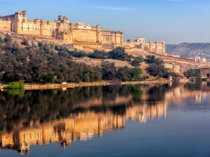 Amber fort palace with reflection on river in Jaipur, India
