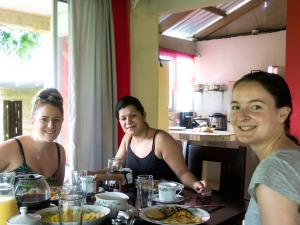 Staff having traditional breakfast with local host in Juanilama accommodation