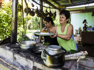 Local Costa Rican's cooking a meal for the network staff on Juanilama excursion