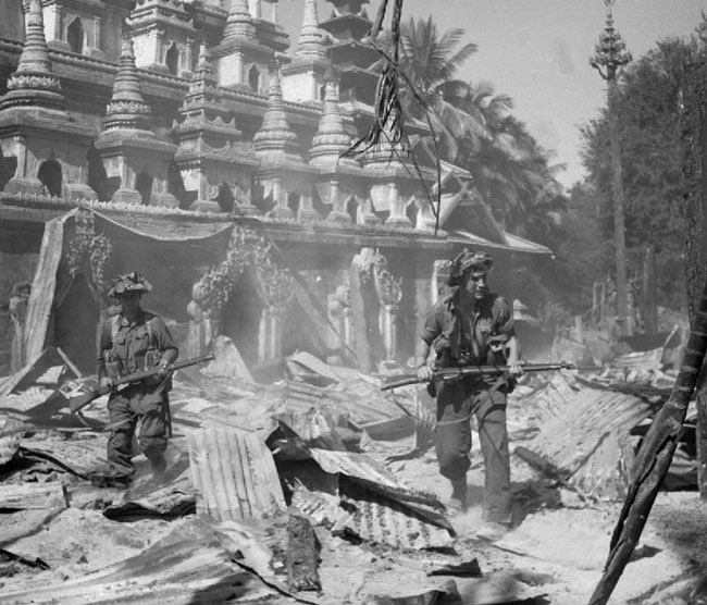 British soldiers patrolling the Burmese town of Bahe during WWII