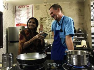 Rickshaw Travel Team cooking with locals in India in Udaipur