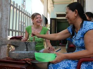 Two ladies sharing Vietnamese food laughing