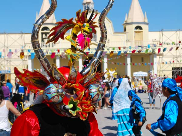 Chile's La Tirana Festival - With a local wearing a traditional mask
