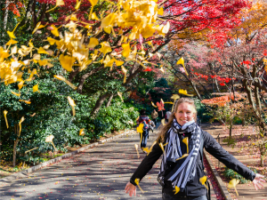 Lady standing amongst autumn leaves in Tokyo park