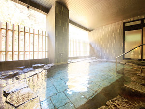 Traditonal Japanese Ryokan onsen stone spa bath from natural spring