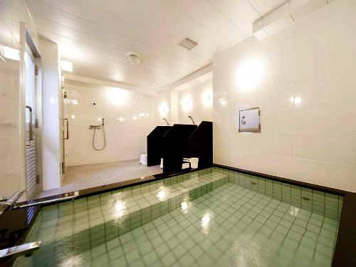 Indoor onsen in tiled room