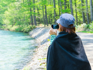 Traveller taking a photo on her smart phone