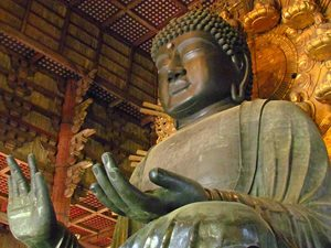 A giant Buddha statue made out of bronze