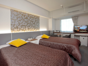 Modern hotel room with twin beds