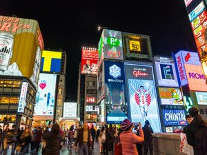 Bright neon lights and signs in the streets of Osaka