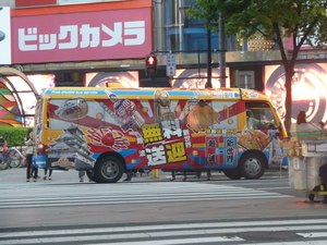 A colourful bus in the streets of Osaka