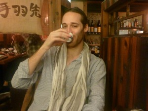 Japan travel specialist drinking sake in Japan