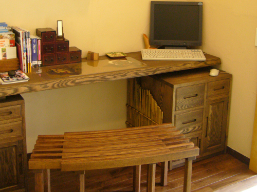 Close-up of desk with computer