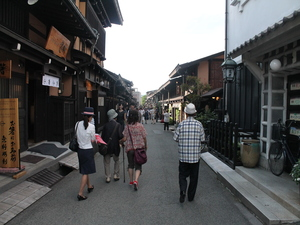 Tourists walking down the streets of Takayama past all the traditional buildings