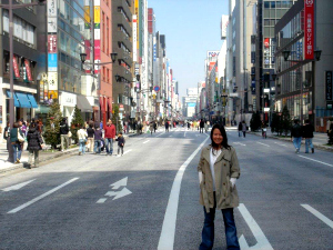Woman standing in a quiet city street