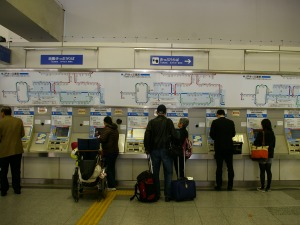 People looking at a subway map in Hiroshima