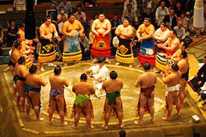 A group of sumo wrestlers prepare to start a tournament