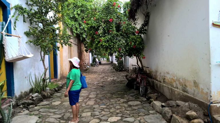 Woman walking around Paraty in Brazil