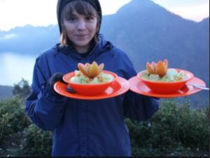 Hannah with her curry dinner at the top of Rinjani