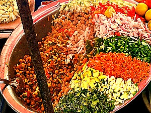 Indian street food with several colours in a big bowl