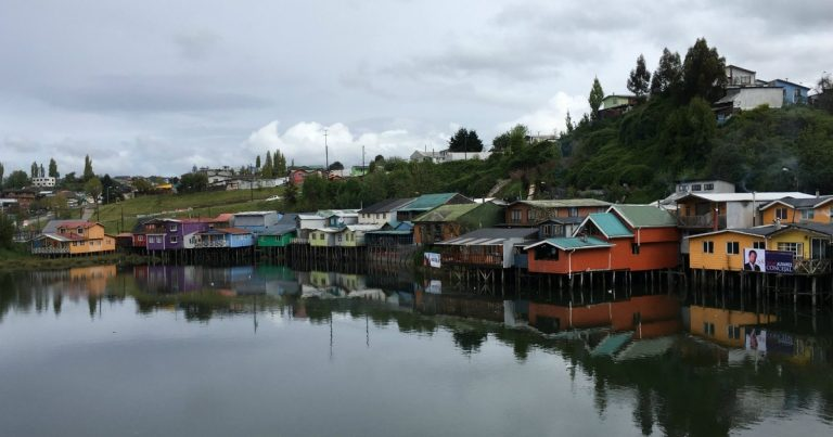 Colourful buildings and homes on stilts in Chiloe water