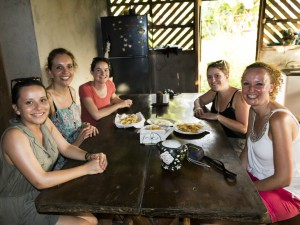 Costa Rica Boca Tapada arrival girls sitting at a table smiling