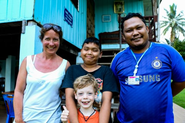 Mother and young son with Thai family in Thailand