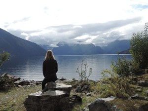 travelling girl staring at landscape Lago Yelcho
