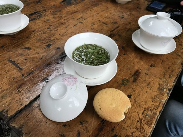Cup of tea and biscuit on table in tea house in Chengdu China
