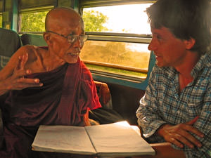 train local monk talking to man in Myanmar