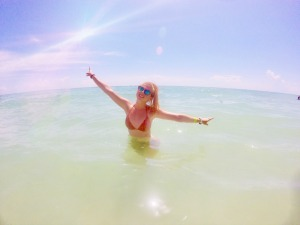 woman in sea with peace sign