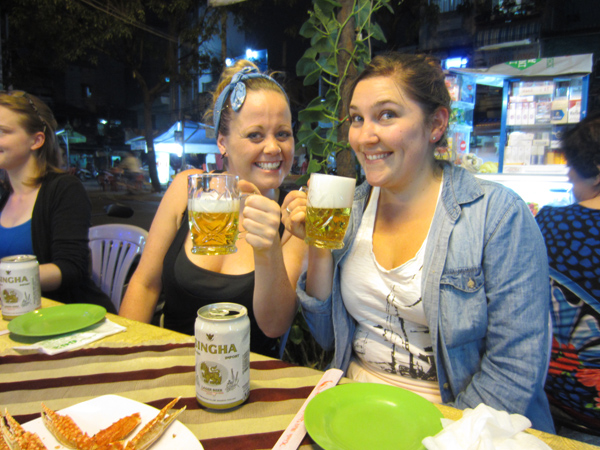 customers drinking beer in the street