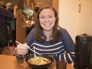 Staff member Fiona in a ramen restaurant in Kyoto eating noodles