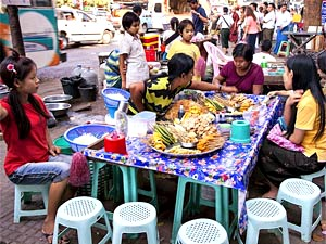 Local people eating around table Mandalay Myanmar