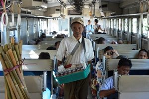 Man selling drinks on train Yangon Myanmar